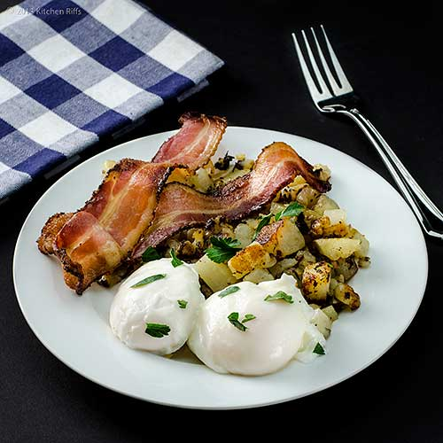 Poached Eggs on Plate with Bacon and Potatoes