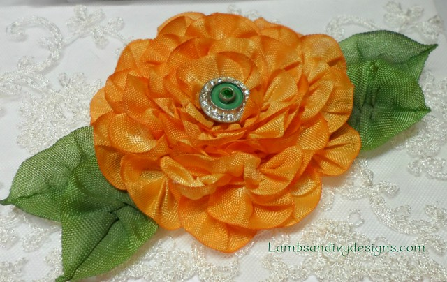 Ribbonwork flower with antique button center