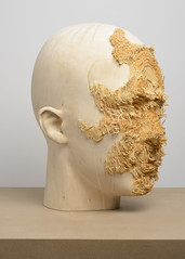<strong>The Tainted - </strong> <br />Aron Demetz, Front (detail, side profile), 2012, Limewood, 50 cm x 40 cm x 62 cm