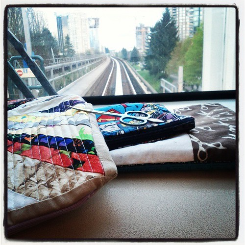 "The very front seat of the #skytrain is the perfect spot for resting my hand sewing. I had to ""touch up"" the zipper for pillow tomorrow."