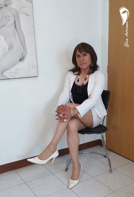 White high heels, white Fitted skirt, black blouse and white coat.