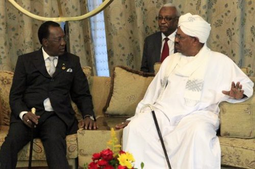 Chad President Idriss Deby meets with President Omar Hassan al-Bashir in Njdamena on February 7, 2013. The two states have had strained relations on the border with the Darfur region of Sudan. by Pan-African News Wire File Photos