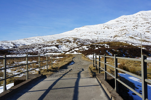 Crossing the bridge and heading down the main track below Lochan na Lairige Reservoir, Meall nan Tarmachan