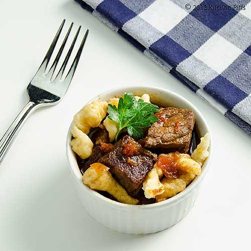 Hungarian Beef Paprika Stew (Pörkölt) in ramekin with Spätzle