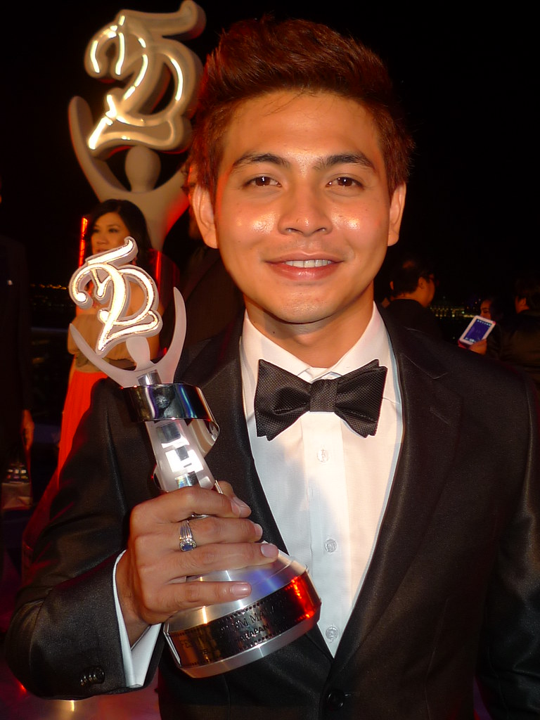 Handsome Izzue Islam holding his Most Promising Actor trophy in Lord's