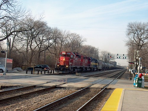 Eastbound Canadian Pacific freight train approaching the North Oak Park Avenue railroad crossing.  December 2006. by Eddie from Chicago