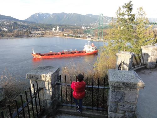 Scott watching a big ship