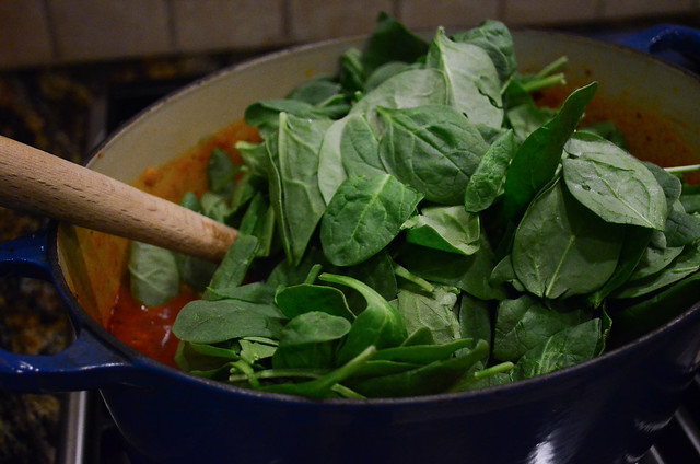 Baby spinach is added to the pot.