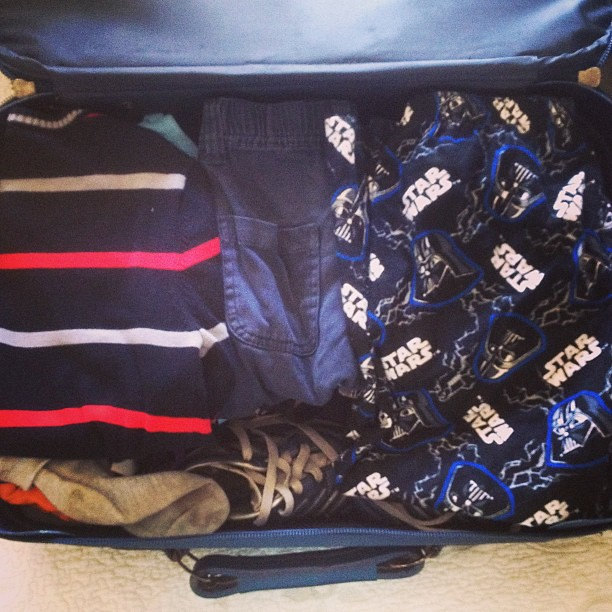 Packing the boy: stripes, Star Wars and soccer boots.