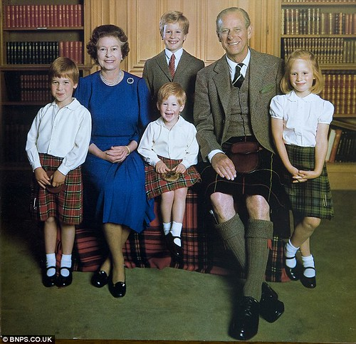 1987 The Queen and Prince Philip pose with their grandchildren (l-r) William, Harry, Zara and her brother Peter (back row) in a warm portrait sent out for Christmas 1987