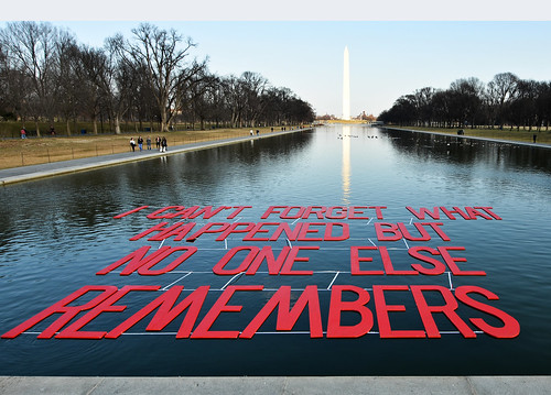 "'I can't forget, but no one else remembers"" floated on reflecting pool."