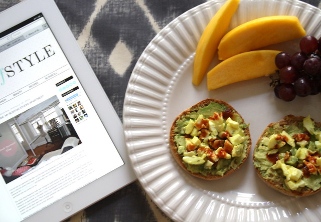 Blogging over breakfast. English muffin with avocado, egg white salad and hot sauce.