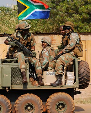South African National Defense Forces troops stationed in the Central African Republic. The soldiers reportedly fired on the Seleka rebels as they moved towards the capital of Bangui. by Pan-African News Wire File Photos