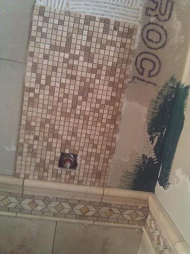 Travertine tile shower in process