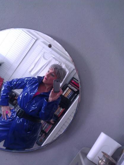 DarkEmeralds in a shiny blue raincoat