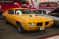 auto show(0.0), convertible(0.0), automobile(1.0), automotive exterior(1.0), vehicle(1.0), stock car racing(1.0), antique car(1.0), land vehicle(1.0), muscle car(1.0), pontiac gto(1.0), coupã©(1.0), sports car(1.0),