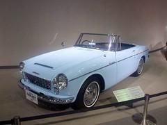sunbeam tiger(0.0), compact car(0.0), automobile(1.0), automotive exterior(1.0), vehicle(1.0), datsun roadster(1.0), sedan(1.0), classic car(1.0), land vehicle(1.0), convertible(1.0), sports car(1.0),