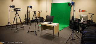 The video production studio has lots of equipment, including a green screen.