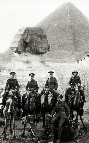 Five soldiers on camels in front of a Sphinx, c.1914-1918