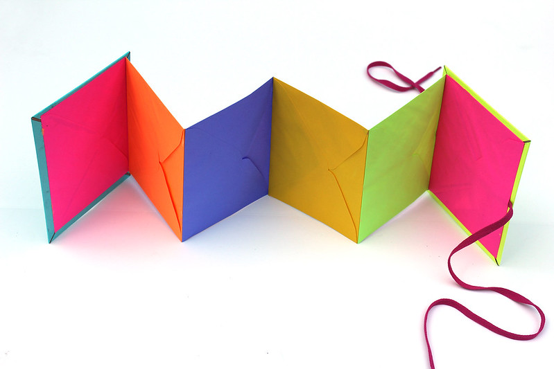 Learn how to make a day-glo envelope book for all your treasures!
