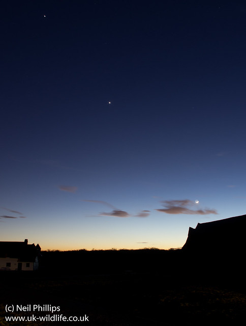 Jupiter Venus and moon aligned with cottage and barn