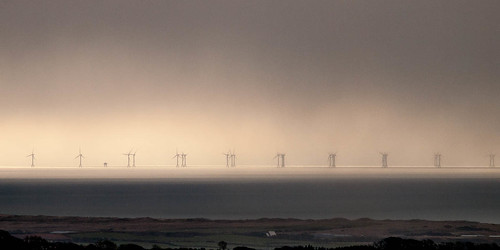 Clearing Winter Storm Over Windfarm