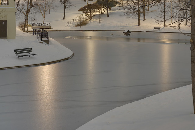 Clifton Heights Park, in Saint Louis, Missouri, USA - lake at night with snow