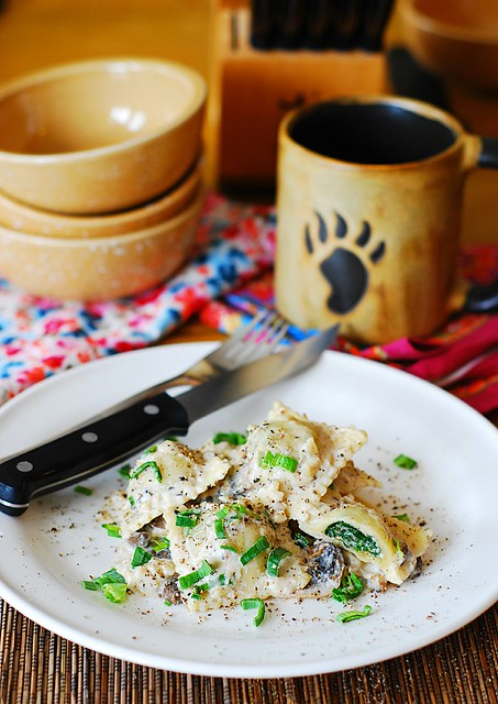 Ravioli with goat cheese and spinach filling in parmesan cream sauce