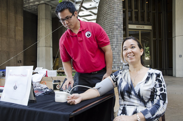 <p>Sen. Jill Tokuda getting her blood pressure checked by a student of the UH Hilo College of Pharmacy.</p>