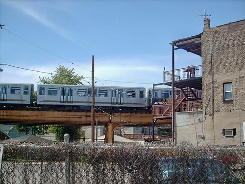 Outbound Chicago Transit Authority blue line train passing through Chicago's Logan Square neighborhood.  Chicago Illinois. July 2007. by Eddie from Chicago