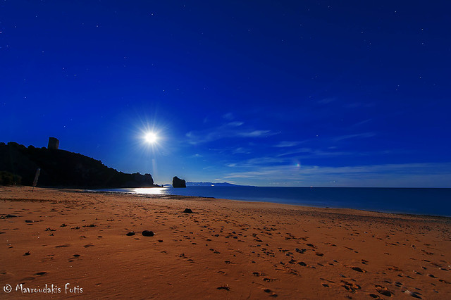 Moonrise over coastline