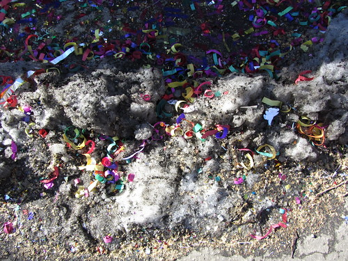 new year's confetti on old snow