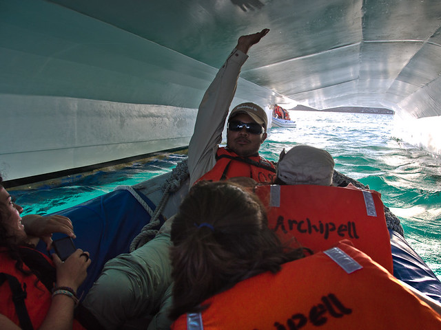 Galapagos Cruises: zodiak boats going under the catamaran