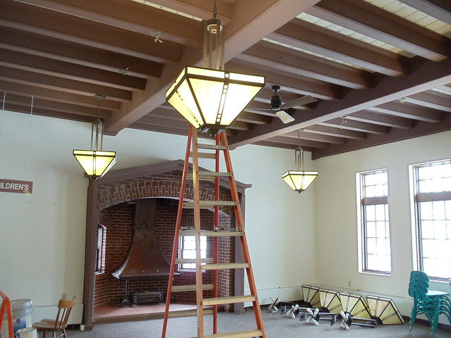 Some pendant lights from reading room are being moved by entryway