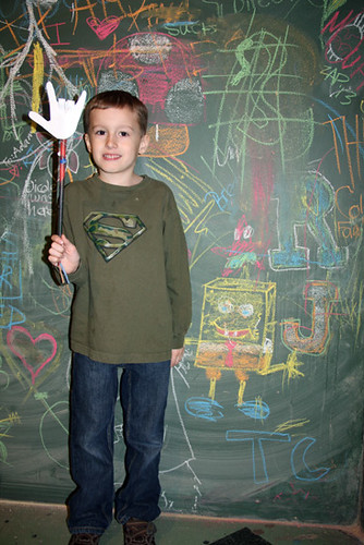 Chalkboard_Nathan-standing-by-it