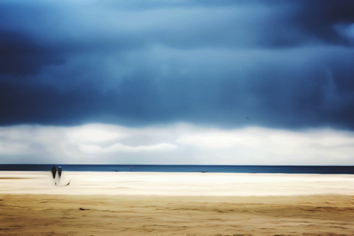 Surreal - Two Figures on Deauville Beach - approaching storm