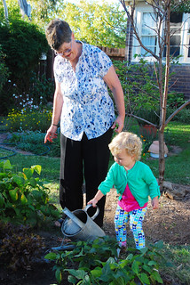 Grandma and Evie in the garden
