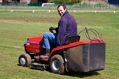 tractor(0.0), outdoor power equipment(1.0), grass(1.0), vehicle(1.0), mower(1.0), lawn mower(1.0), lawn(1.0),
