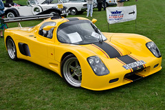 koenigsegg cc8s(0.0), race car(1.0), automobile(1.0), vehicle(1.0), automotive design(1.0), ultima gtr(1.0), sports prototype(1.0), land vehicle(1.0), supercar(1.0), sports car(1.0),