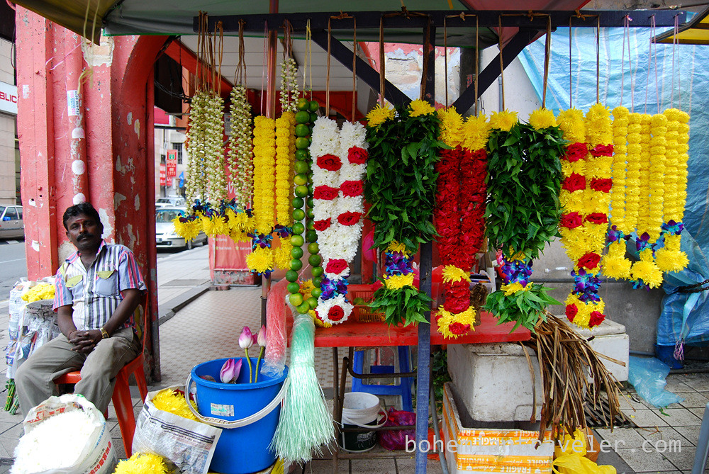 selling flowers outside a Hindu Temple in China Town KL Malaysia