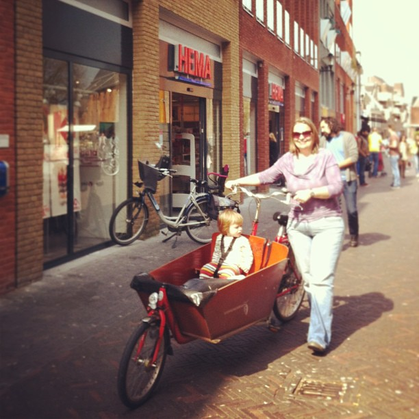 trip to Hema in proper dutch toddler transport (3mai in NL).