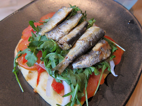 Little Sardines, Piquillo Peppers, Rocket, Tomato, Onion on Coca Bread