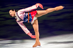 skating(1.0), ice dancing(1.0), winter sport(1.0), individual sports(1.0), sports(1.0), recreation(1.0), axel jump(1.0), outdoor recreation(1.0), ice skating(1.0), gymnast(1.0), figure skating(1.0),