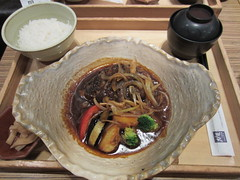 Handmade hamburger steak with rolled barley and japanese style demiglaze sauce in clay pot set