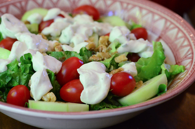 Light and Creamy Blue Cheese Dressing served on top of salad.