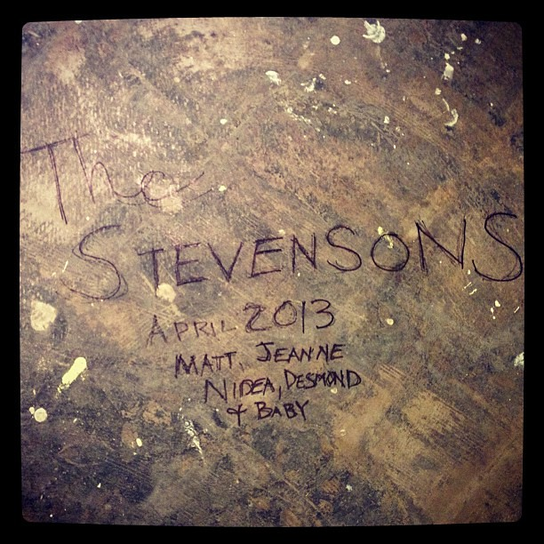 I left this message on the concrete floor for whoever pulls up the carpet that is being installed over it today. #timecapsule #renovation #hiddenmessage #latergram