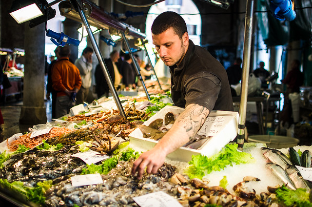 A tattooed fishmonger at Venice's Rialto Market.