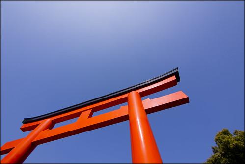 Torii in red under a blue Kobe sky