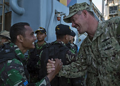 Electronics Technician 1st Class Anthony Nekervis shakes hands with an Indonesian counterpart during a previous CARAT exercise. (U.S. Navy/MC3 Amanda S. Kitchner)