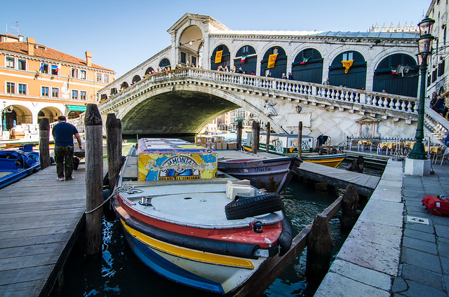 Beneath the Rialto bridge, a boat transporting gelato through the canals of Venice.